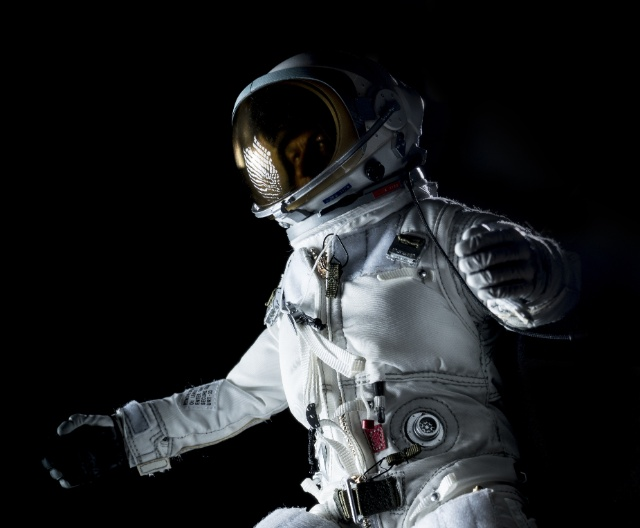 astronaut in a space suit floating in space logo
